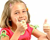 little girl making positive signs with thumbs