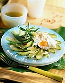 Marinated avocado salad with poached egg and Comt&#233; cheese flakes
