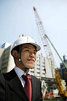 Businessman with a hard hat, portrait