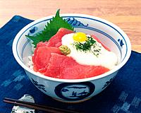Bowl of Rice Topped with Slices of Raw Tuna, High Angle View