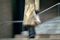 Businessman walking down the stairs, low angle view, blurred motion, New York City, NY, USA