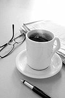 one cup of black coffee and newspaper