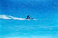 cancun mexico one person riding a jet ski in yucatan beach