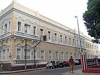 one man walking in front of a historical building in fortaleza