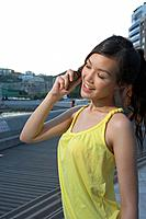 Young Lady Using Mobile Phone, Eyes Closed (thumbnail)