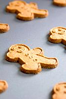 Gingerbread men on baking tray