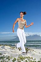 South Africa, Cape Town, Young woman jogging on beach
