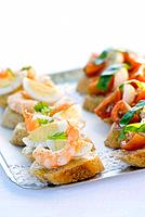 Canapés with prawn, egg, tomato, mozzarella on tray