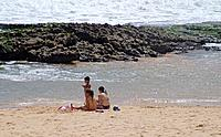 three people enjoying jenipabu beach