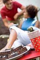Brownies at garden party for 4th of July, couple in background
