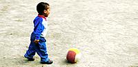 one little boy playing soccer