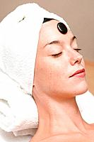 Woman having LaStone Therapy healing therapy using stones