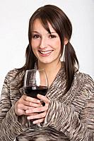 Young woman holding a glass of red wine