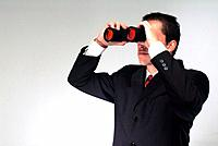 man using binoculars to watch