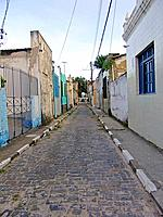 a narrow street with parallelepipids at bahia