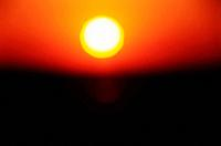 the sun setting down his light