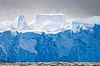 Fierce gale-force winds carving tabular icebergs below the Antarctic Circle around the Antarctic Peninsula during the summer months  More icebergs are...