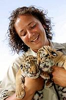 Arkansas, Eureka Springs, Turpentine Creek Wildlife Refuge, rescuing exotic wild cats, tiger cubs, eyes closed, woman, staff zoologist, handler,