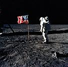 a person astronaut looking the american flag