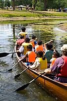 Asian kids paddle Phalen Creek under the auspices of Wilderness Inquiry  Dragon Festival Lake Phalen Park St Paul Minnesota USA