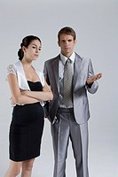 Businessman and Businesswoman standing