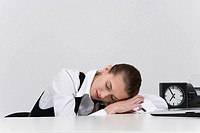 Young businesswoman sleeping with head on table