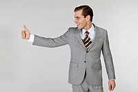Businessman gesturing sign language