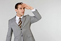 Businessman standing with hand on head