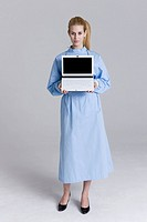 Female surgeon holding a laptop