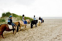 Children at riding horses at the Ridecenter Vinterlejegaard situated in a dune landscape on the isthmus Holmsland Klit , West Jutland Denmark