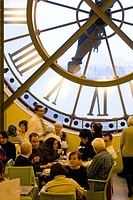 Patrons inside a cafe with a large clockface in the Musee d´Orsay, Paris, France
