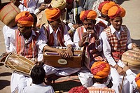 Musicians waiting at the Jaisalmer festival , Rajasthan, India