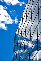 Reflection of clouds in a glass_facade