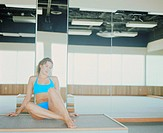Female sitting in dance studio