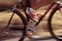 Close up of wheels/frame of a bicycle, blurry