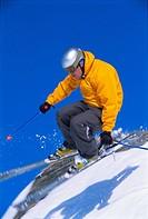 Skier jumping on snowy hill blur