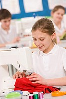 Female student using sewing machine