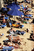 France. Paris. People sunbathing on the bank of River Seine during Paris Plage