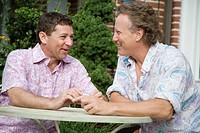 Two mature men talking together