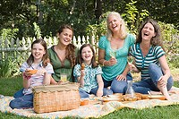Two families having picnic in a park
