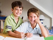 Two Young Boys Doing Their Homework Together