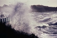 waves crashing on bridge during storm