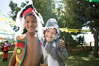 Boys in indian and shark costumes at party