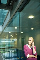 Woman in Office on Cell Phone