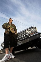 Man standing in front of car low angle view