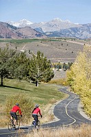 Couple road biking, Sun Valley, Idaho, USA