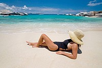 Woman laying on beach, The Baths, Virgin Gorda, British Virgin Islands