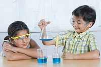 Boy and a girl doing scientific experiment in a laboratory