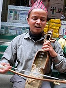 Nepali musician playing traditional instrument
