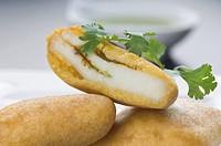 Close_up of three bread pakoras
